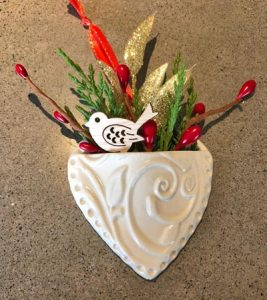 Make this heart-shaped ornamental wall vase at Stone Circle Pottery's Christmas Ornament Pottery Workshop